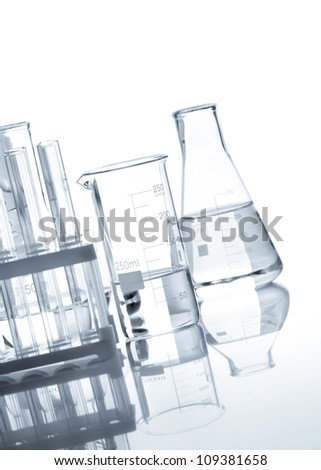 Glass flasks with a clear liquid, isolated - stock photo