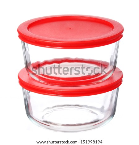 glass food containers with red plastic lids isolated on white background - stock photo
