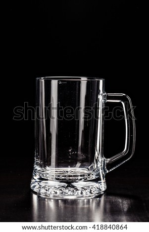 Glass for BEER on black. EMPTY GLASS. Glass of alcohol. Closeup Cold Beer. Pint of beer. Good for brewery commercial - stock photo