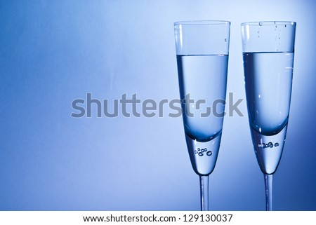 glass for champagne  on blue and red background