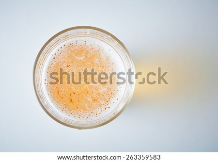 glass full of beer, view from above