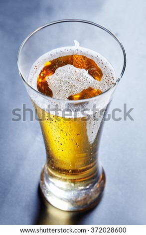glass full of beer, view from above - stock photo