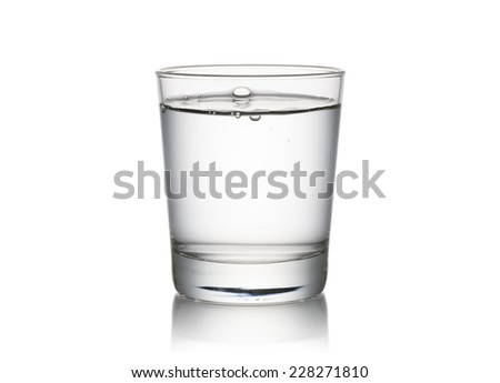 glass full of fresh water, on white background - stock photo