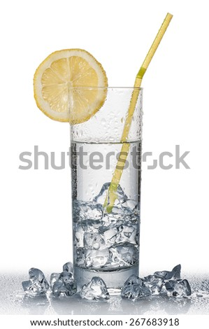 glass full of fresh water with lemon and ice cube, on white background - stock photo
