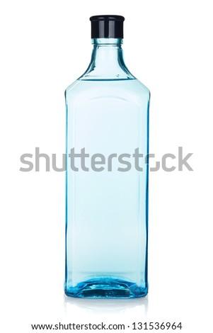Glass gin bottle. Isolated on white background - stock photo