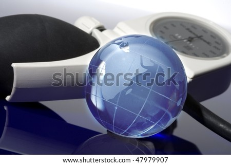 Glass globe with blood pressure on blue background
