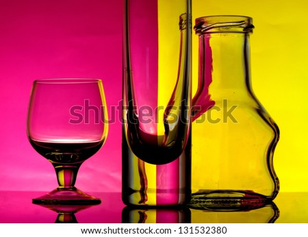 Glass goblets on a colored background abstract