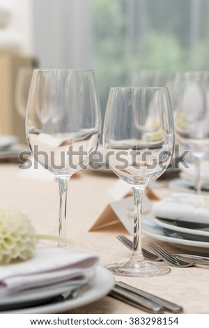 glass goblets on table in restaurant - stock photo