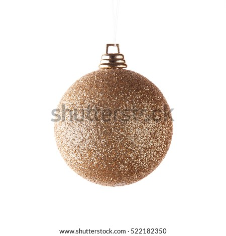 Glass golden toy for decoration of a Christmas and New Year fir tree on a white background.