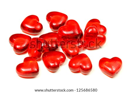 Glass hearts on white background.