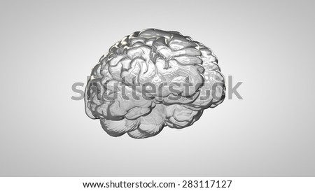 Glass human brain on a gray background