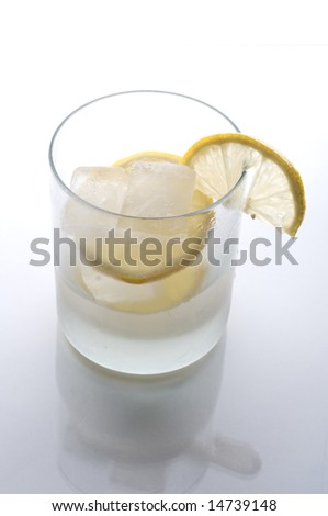 Glass iwth ice and lemon on white