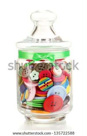 Glass jar containing various colored buttons isolated on white - stock photo