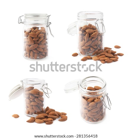 Glass jar filled with almond seeds isolated over the white background, set of four different foreshortenings - stock photo