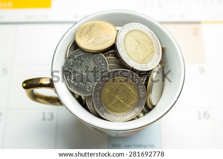 glass jar for tips with money isolated on white. Thailand coins - stock photo
