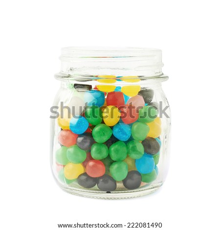 Glass jar full of colorful candy ball sweets, composition isolated over the white background