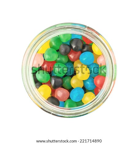 Glass jar full of colorful candy ball sweets, composition isolated over the white background, top view above - stock photo