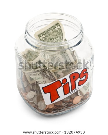 Glass Jar half full of money with a tips label on it, isolated on a white background with drop shadow.
