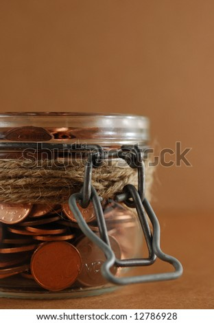 Glass Jar of coins. Savings Concept - stock photo