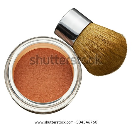 Glass jar of cosmetics foundation powder with a thick soft bristle brush for application in a high angle view conceptual of beauty products