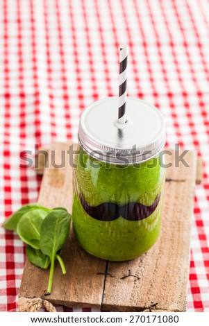 Glass jar of fresh and healthy green smoothie - stock photo