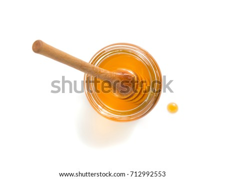 glass jar of honey isolated on white background