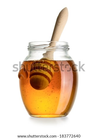 Glass jar of honey with dipper isolated on white background - stock photo