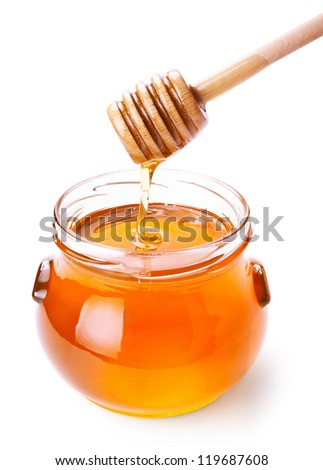 Glass jar of honey with wooden drizzler isolated on white background - stock photo
