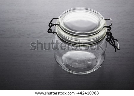 Glass Jar on Wooden Background - stock photo