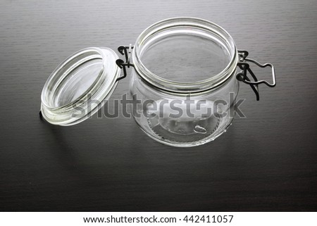 Glass Jar on Wooden Background