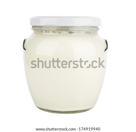 glass jar with a lid with liquid on a white background