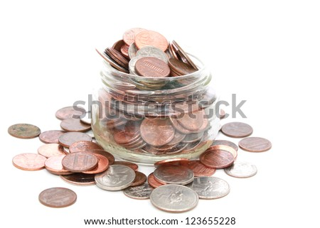 Glass jar with American coins - stock photo
