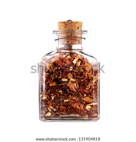 glass jar with colorful flower petals isolated on white background - stock photo