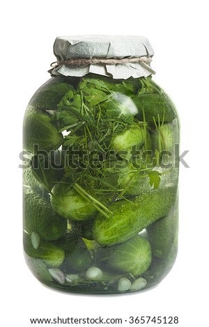 glass jar with cucumbers isolated on white background