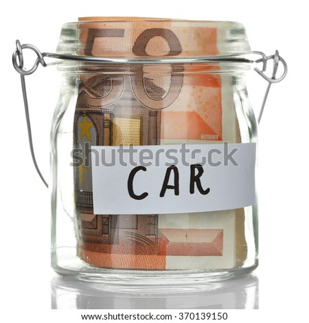 Glass jar with euro banknotes for  car, isolated on white - stock photo