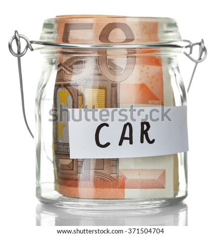 Glass jar with euro banknotes for  car, isolated on white
