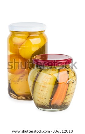 Glass jar with grilled zucchini slices and yellow tomatoes isolated on white background - stock photo