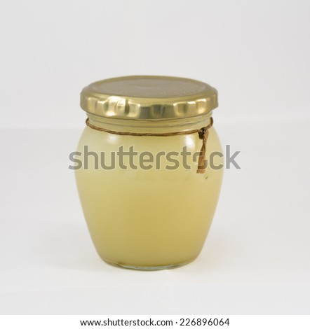 Glass jar with neutral colored balm or massage butter - stock photo
