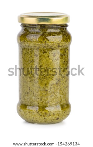 Glass jar with pesto sauce isolated on the white background - stock photo