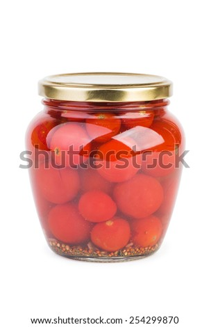Glass jar with pickled cherry tomatoes over the white background - stock photo