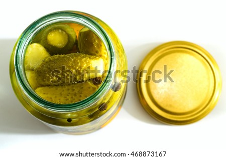 glass jar with pickled cucumbers on white background