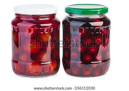 Glass jar with preserved plums and cherries isolated on white background - stock photo