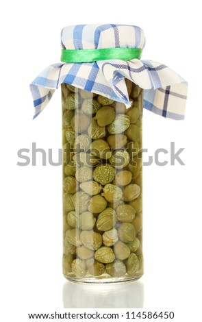 Glass jar with tinned capers isolated on white - stock photo