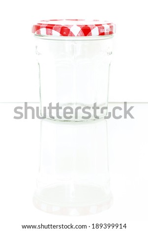 Glass jar with white bow isolated on white background - stock photo