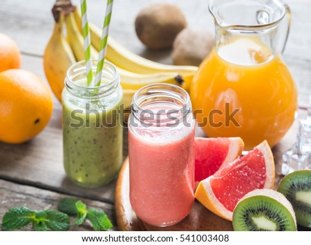 Glass jars of fruit  smoothies