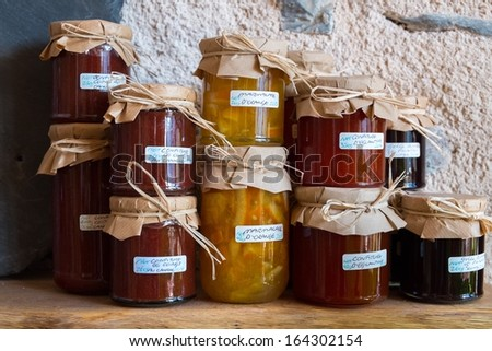 Glass jars with a different type of jams  - stock photo