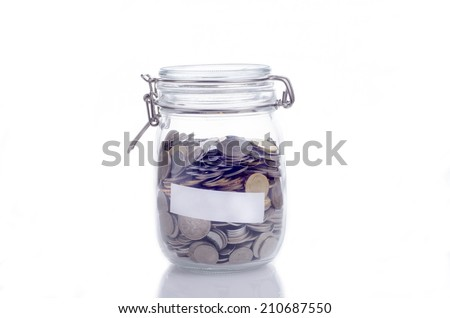 Glass jars with coins and empty space for text - stock photo