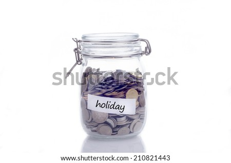 Glass jars with coins and 'holiday' text