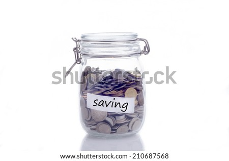 Glass jars with coins and 'saving' text - stock photo