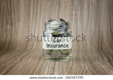 Glass jars with coins labeled Car Insurance. Financial Conceptual - stock photo